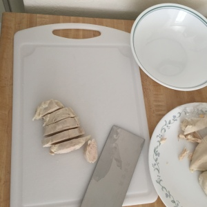 Cutting up some boiled chicken breast